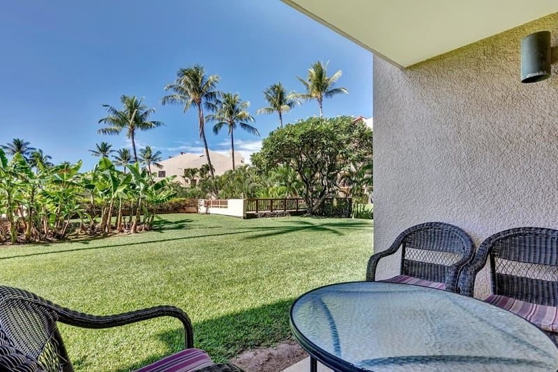 View from the lanai on the ground floor; access to open grassy area, pool and short walk to the beach